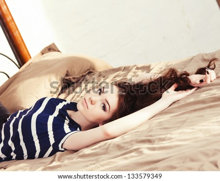 Sensual woman lying on the bed