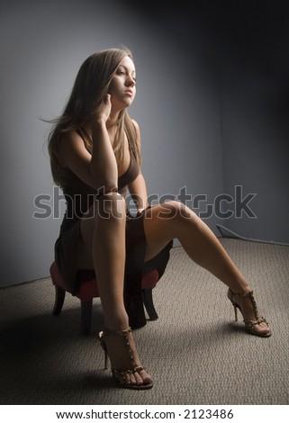 sensual woman wearing evening dress - stock photo