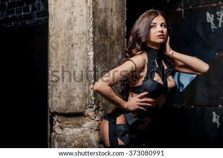 Sensual woman with beautiful body and designer dress