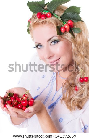 Sensual woman with cherries in hands and hair isolated over white