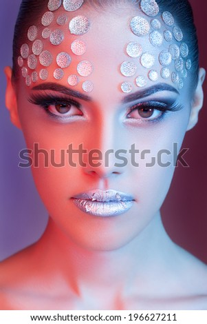 Sensual woman with fashion rhinestone make up. Blue and red colors on background. High end retouching. Clean skin with texture - stock photo