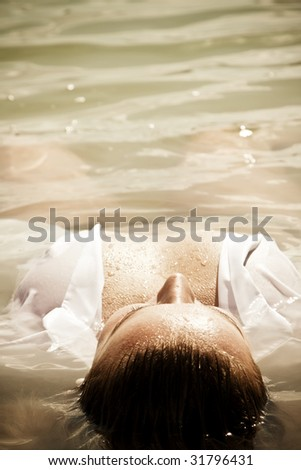 Sensual woman with part of her body out of the water