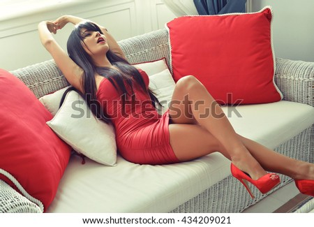 sensual woman with perfect sexy legs in red dress - stock photo