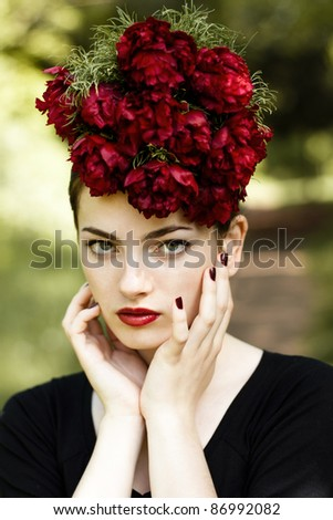 Sensual woman with red lipstick and flowers on the head. Outdoor portrait