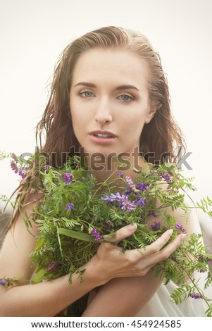 Sensual woman with wild flowers
