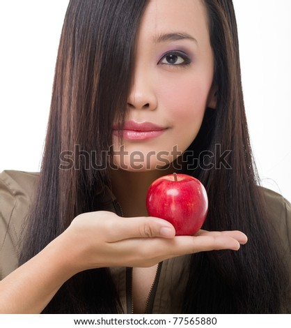 Sensual young attractive woman portrait holding red apple on hand, isolated background
