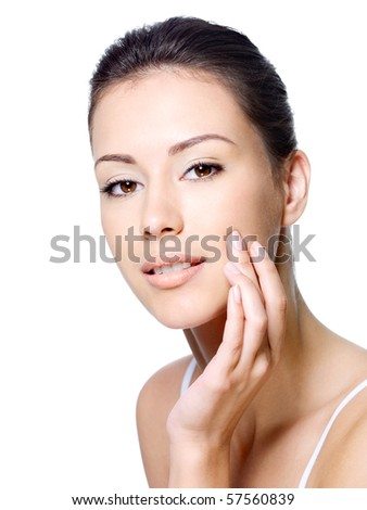 Sensual young beautiful woman stroking her healthy clean skin on face - isolated - stock photo