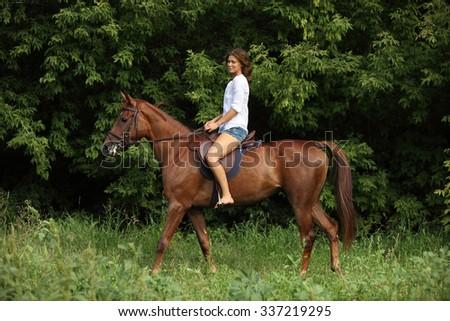 Sensual young beauty country girl ride horseback - stock photo