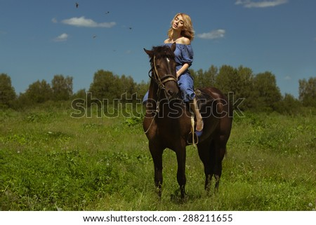 Sensual young beauty riding a horse - stock photo