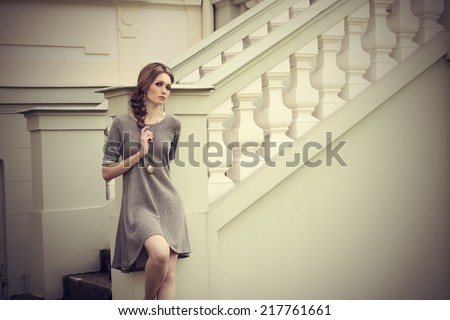 sensual young girl in fashion pose in outdoor location with elegant dress, stylish braid hair-style and cute jewellery  - stock photo