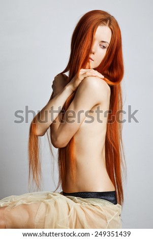 Sensual young red-haired girl - stock photo