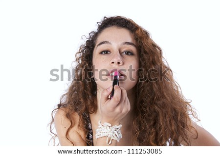 Sensual young woman applying lipstick (isolated on gray)