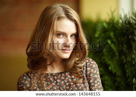 Sensual young woman looking at camera with calm expression