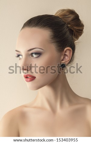 Sensual young woman portrait against studio background - stock photo