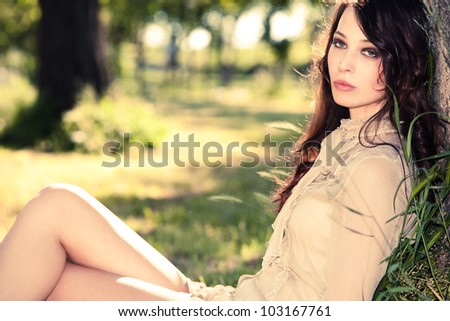 sensual young woman relax in park on grass, summer day - stock photo