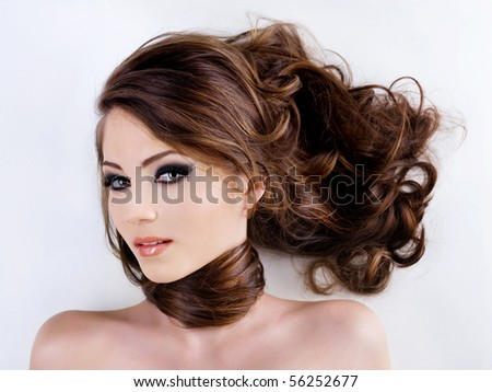 Sensuality and attractive young woman face with beauty hairs - stock photo