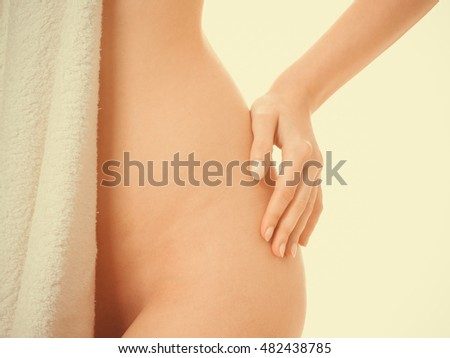 Sensuality and sexuality of women. Perfect female part body covered by bath towel. Seductive woman with naked sexy ass.