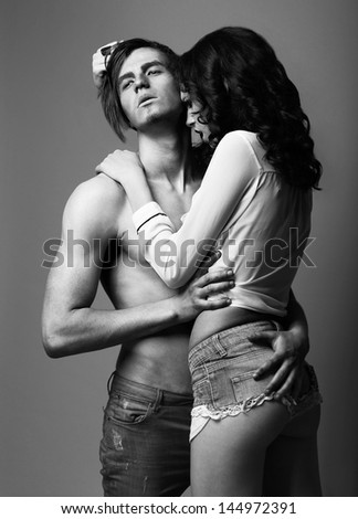 Sensuality. Love. Young Man and Woman in Cuddle - stock photo
