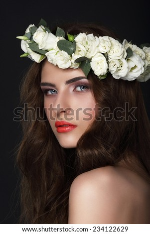 Sensuality. Young Brunette wearing Wreath of Roses - stock photo