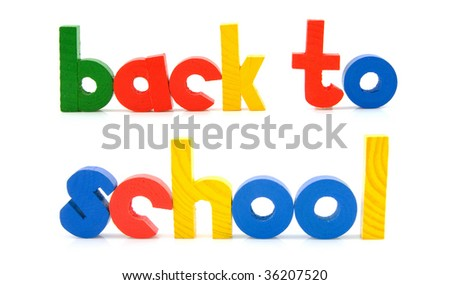 Sentence Back to school in colorful wooden letters over white background - stock photo