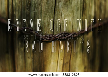 Sentence break off with bad habits written on natural wooden background with metal wire in a middle.  - stock photo