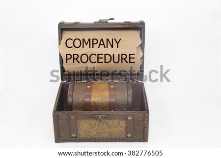 sentence company procedure written with pen on a , on a wooden treasure chest. isolated on white background