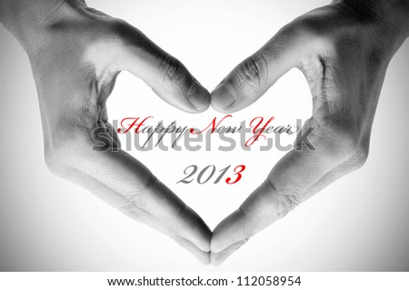 sentence happy new year 2013 and hands forming a heart