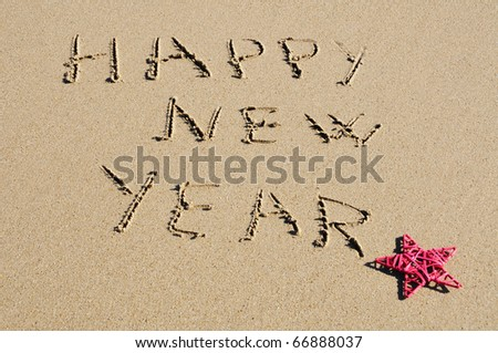 sentence happy new year written in the sand - stock photo