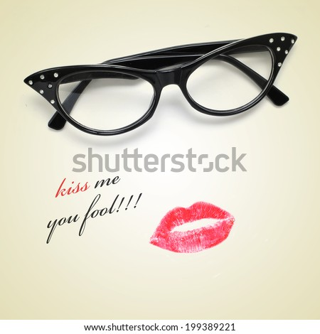 sentence kiss me you fool and retro-styled eyeglasses and a lipstick mark