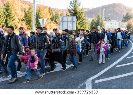 SENTILJ, SLOVENIA - 15 OCTOBER 2015: Syrian refugees on the road from the accommodation camp to the Slovenian Austrian border