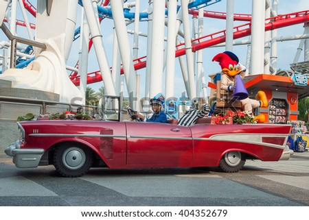 """Sentosa Universal Studios, Singapore - 1 March, 2014 : Woody woodpecker on antique car in the """"Hollywood Dreams Parade"""" - stock photo"""