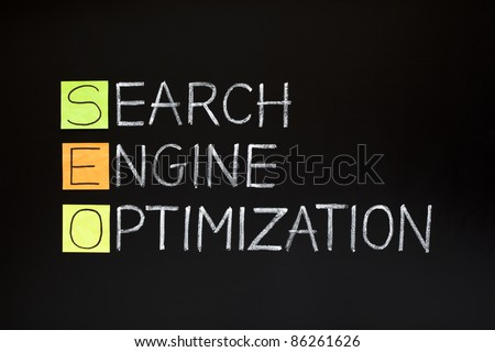 SEO acronym - SEARCH ENGINE OPTIMIZATION made with sticky notes and white chalk on a blackboard - stock photo