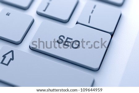 SEO button on keyboard with soft focus - stock photo