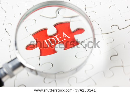 SEO concept - Magnifying glass searching missing puzzle peace. Business concept. - stock photo