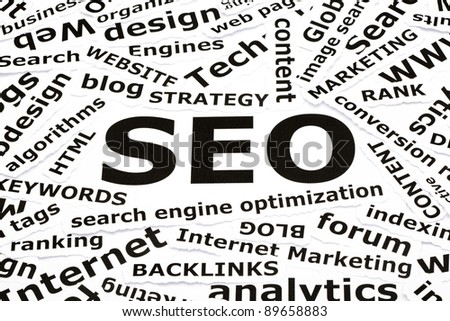SEO concept with other related words printed on paper - stock photo