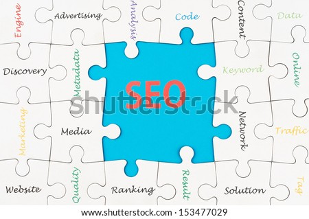 SEO concept words on group of jigsaw puzzle pieces - stock photo