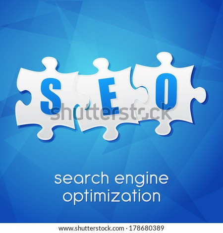 SEO in puzzle pieces, search engine optimization text over blue background, flat design, business technology concept words - stock photo