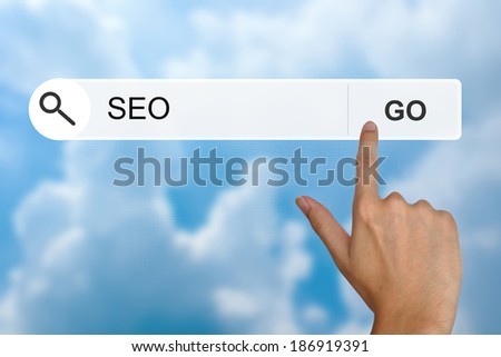 SEO or search engine optimization button on search toolbar - stock photo