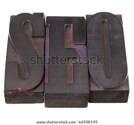 SEO (search engine optimization ) acronym - word in antique letterpress printing blocks, stained by color inks, isolated on white - stock photo