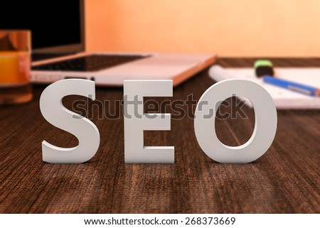 SEO - Search Engine Optimization - letters on wooden desk with laptop computer and a notebook. 3d render illustration. - stock photo