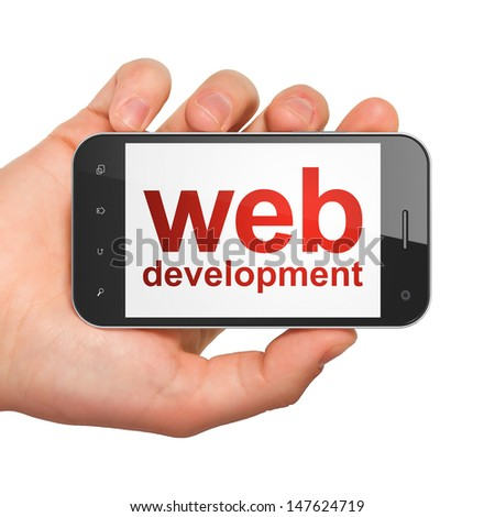 SEO web development concept: hand holding smartphone with word Web Development on display. Generic mobile smart phone in hand on White background. - stock photo
