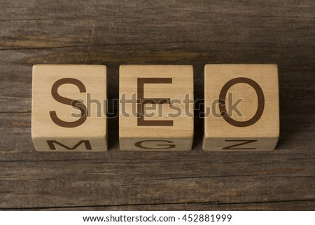 SEO word on wooden cubes - stock photo