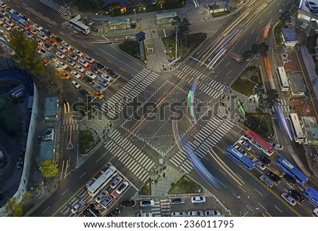 SEOUL - CIRCA NOVEMBER 2014.  As in many other major global city centers, Seoul has its urban congestion and road traffic as this intersection located in the heart of Seoul demonstrates. - stock photo
