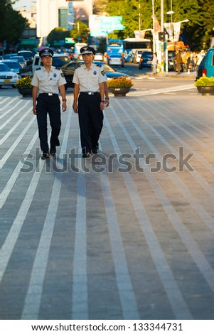 SEOUL, KOREA - AUGUST 28, 2009: Young Korean men patrol the downtown streets as civilian police, an alternative to mandatory military service in Seoul, South Korea on August 28, 2009 - stock photo