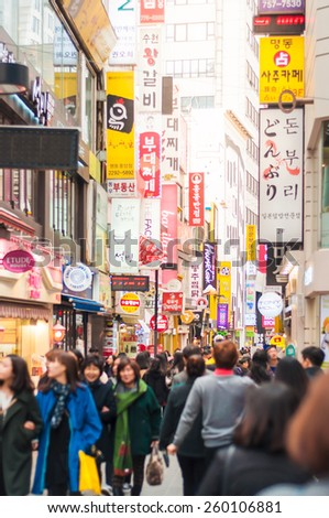 SEOUL, KOREA - FEBRUARY 25, 2015 : People at Myeong-Dong in sunlights .The location is the premiere district for shopping in the city. - stock photo