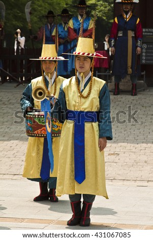 Seoul, Korea - May 14, 2015: Armed guards in traditional costume guard the entry gate at Deoksugung Palace