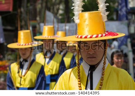 SEOUL KOREA MAY 21: Deoksugung Palace Royal Guard-Changing Ceremony on May 21 2013 in Seoul. This tradition is similar to the changing of the guard at Buckingham Palace in England.