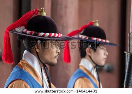 SEOUL KOREA MAY 21: Deoksugung Palace Royal Guard-Changing Ceremony on May 21 2013 in Seoul. This tradition is similar to the changing of the guard at Buckingham Palace in England. - stock photo