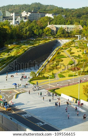 SEOUL, KOREA - SEPTEMBER 22: Aerial view of students walking around Ewha Campus Center at Ewha Womans University, the world's largest all female institute on September 22, 2009 in Seoul, Korea - stock photo