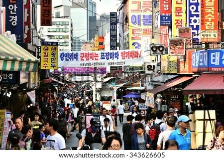 SEOUL, KOREA - SEPTEMBER 21, 2015: Crowded shopping street in Namdaemun market area - stock photo